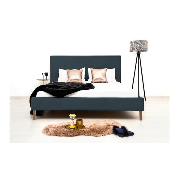 Tmavě modrá postel s přírodními nohami Vivonita Kent,140x200cm
