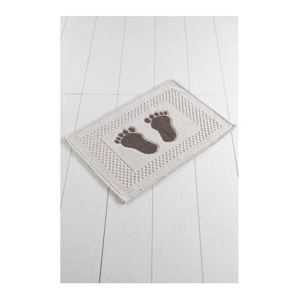Brązowo-beżowy dywanik łazienkowy Carrisma Lusmo, 70x50 cm