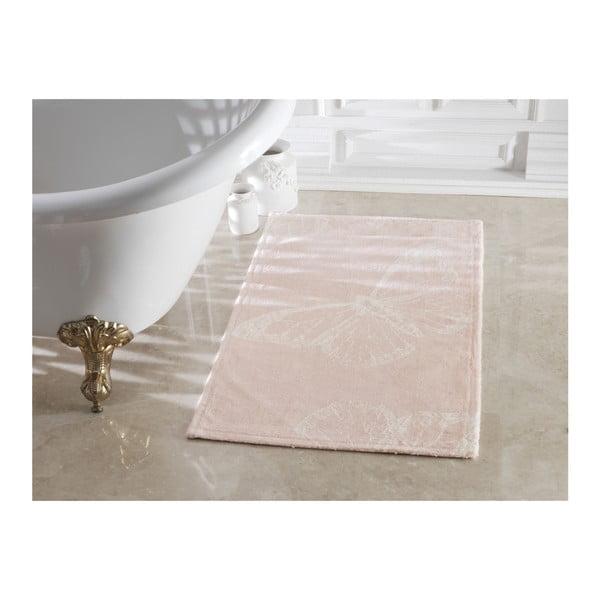 Jasnoróżowy dywanik łazienkowy Madame Coco Butterfly Powder Ecru, 70x120 cm