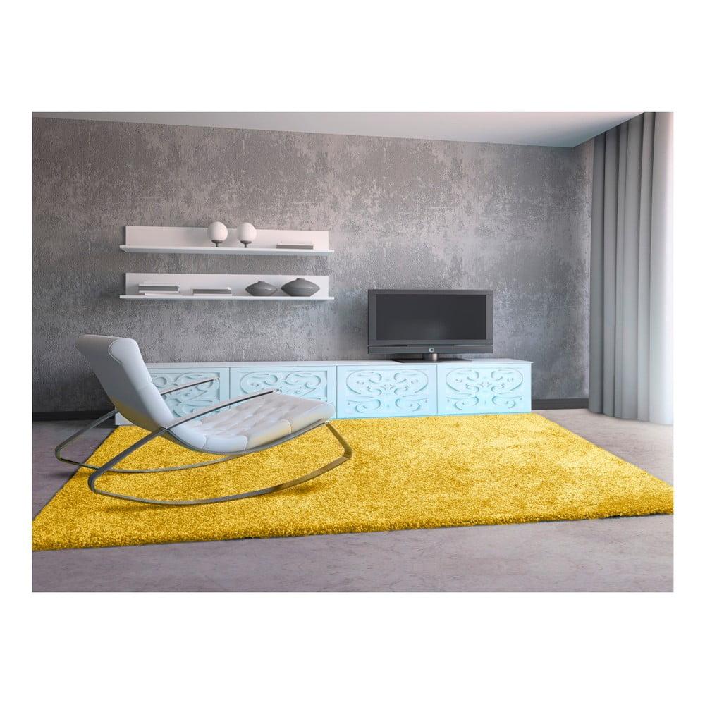 Produktové foto Žlutý koberec Universal Aqua Liso, 67 x 125 cm
