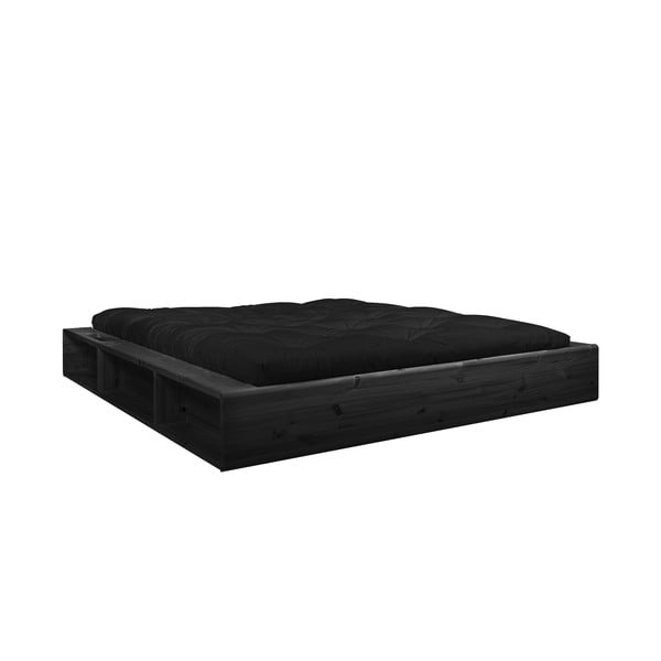 Černá dvoulůžková postel z masivního dřeva s úložným prostorem a černým futonem Comfort Karup Design, 180x200cm