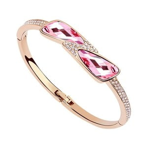 Náramek s růžovými krystaly Swarovski a růžovým zlatem Bow