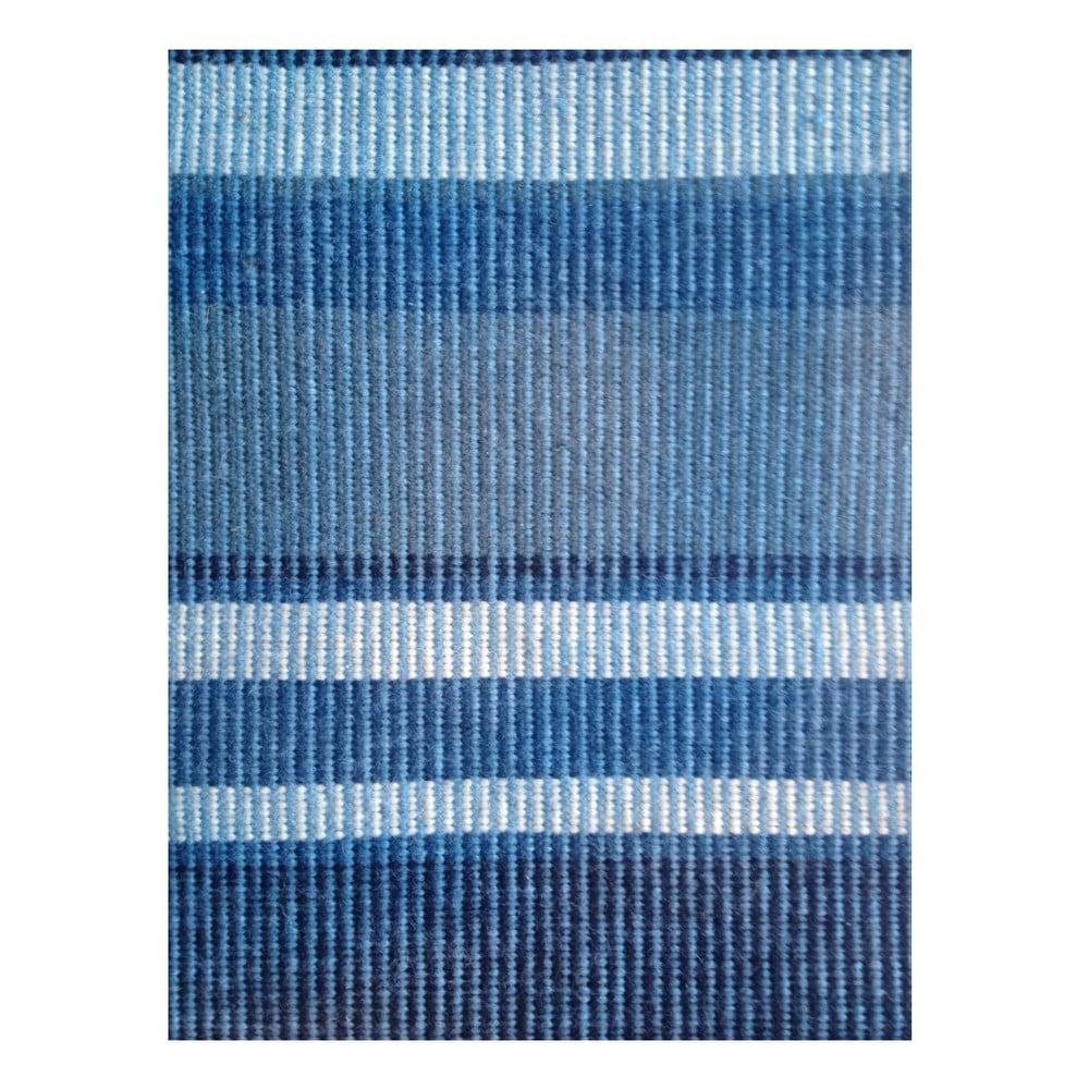 Modrý ručně tkaný vlněný koberec Linie Design Romina, 170 x 240 cm