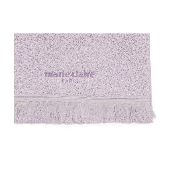 Fialový ručník na ruce Marie Claire