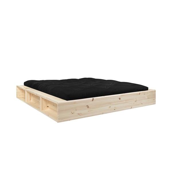 Dvojlôžková posteľ z masívneho dreva s úložným priestorom a čiernym futónom Comfort Mat Karup Design, 180 x 200 cm