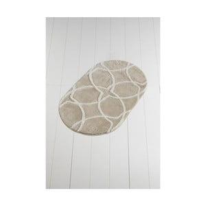 Světle béžová koupelnová předložka Confetti Bathmats Bonne Oval Rock, 60 x 100 cm