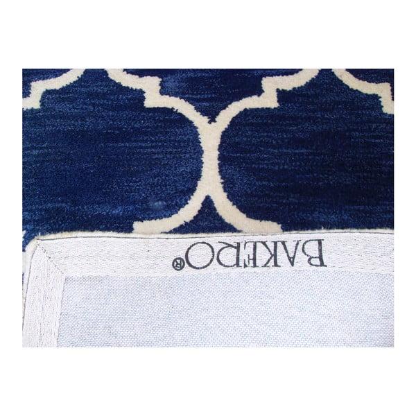 Ručně tuftovaný tmavě modrý koberec Bakero Florida, 78x244cm