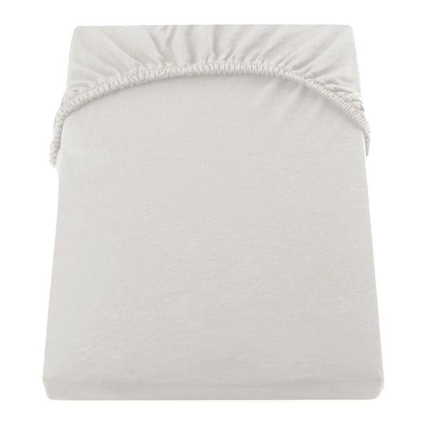 Kremowe bawełniane prześcieradło elastyczne DecoKing Amber Collection, 120-140x200 cm