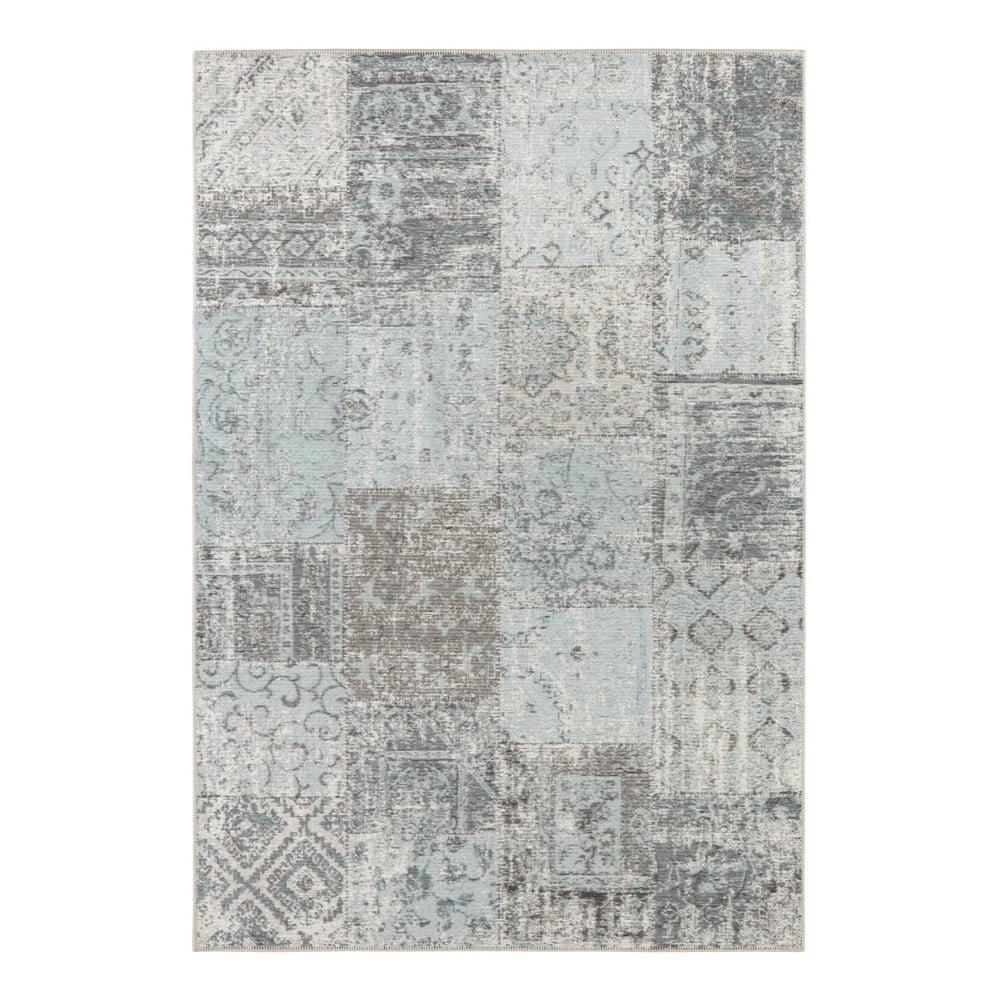 Světle modrý koberec Elle Decor Pleasure Denain, 120 x 170 cm