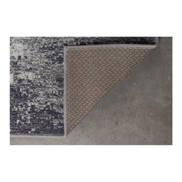 Modrý koberec Dutchbone Caruse, 170x240cm