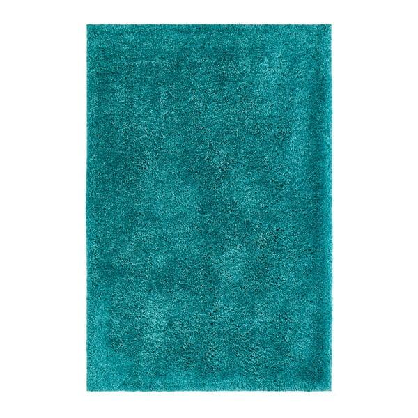 Petrolejový ručně vyráběný koberec Obsession My Touch Me Petr, 110 x 60 cm