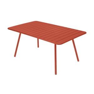 Oranžovočervený kovový jídelní stůl Fermob Luxembourg
