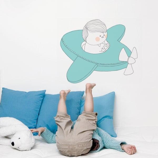 Samolepka na zeď Little boy in a blue plane, 62x52 cm